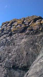 Tom and Joe high on Lamorna Wall